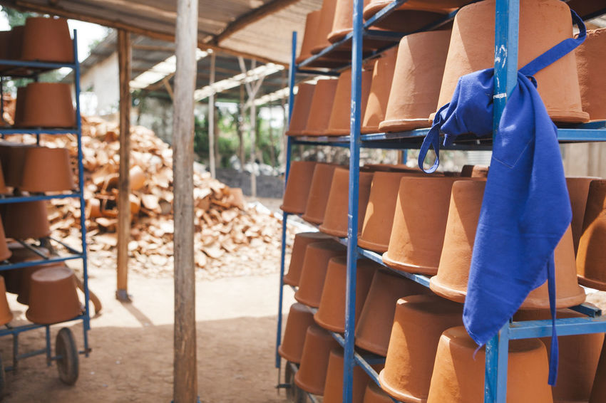 Africa African Broken Business Ceramic Clay Day Entrepreneurship Factory Filter Industry No People Pottery Recycle Recycling Shade Shelf Shelves Social Business Stacked Structure Terracotta Warehouse Water Filter Workshop