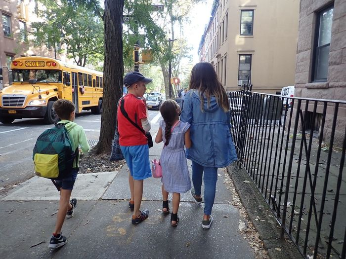 Kids walking to the school bus. Walking Real People Full Length Outdoors Childhood Adult Elementary Age