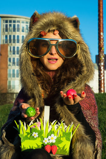 Portrait Of Young Woman Wearing Large Sunglasses At Park