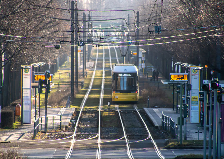Tram on railroad track in city