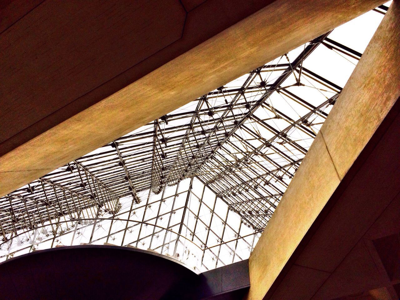 Low angle view of geometric shapes in musee du louvre