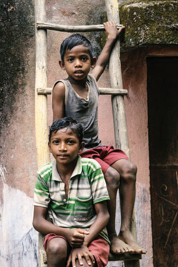 Jharkhand, India Village India Jharkhand Nature Landscape People Colors Silent Moment Silent Pure Life Pure Beauty Child Childhood Boys Portrait Sitting Looking At Camera Men Males  Emotion Innocence Serious Architecture