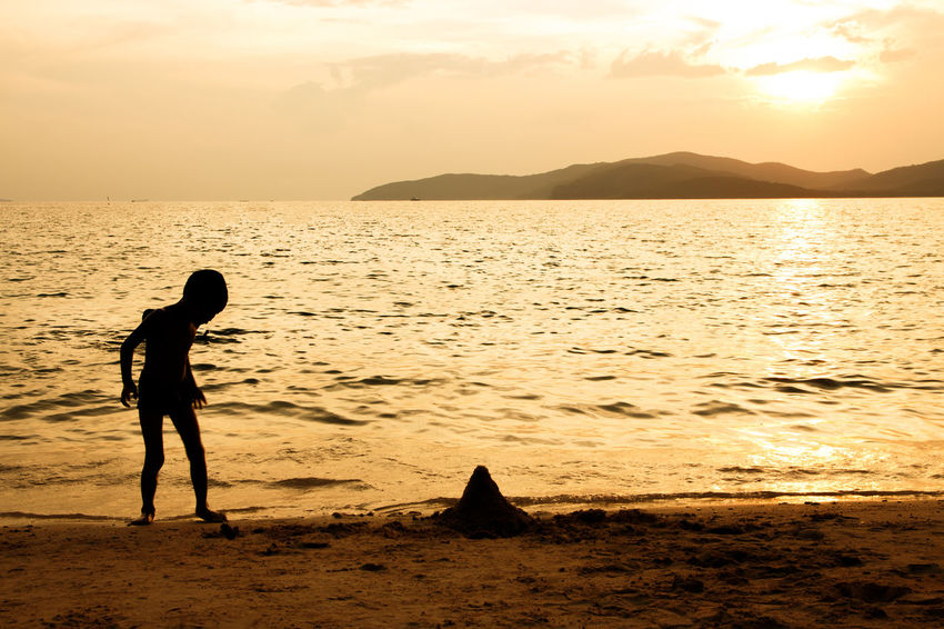 silhouette of people at the beach,The beauty of natural light at sunset. Sunset Water Sky Sea Beauty In Nature Silhouette Scenics - Nature Real People Land Lifestyles One Person Beach Nature Tranquil Scene Orange Color Tranquility Leisure Activity Idyllic Horizon Over Water Outdoors Silhouette Happiness Happy People Holiday Relaxing Children Women Man Romantic Orange Clouds And Sky Love Family Summer Sunrise Boy Freshair Freedom Fun