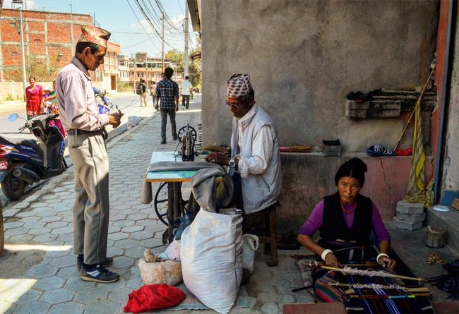 Tailors on the street of Swayambunath on a mid day. Streetphotography