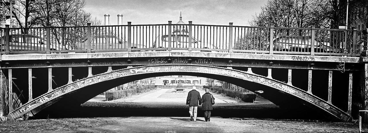 Old couple walking Under The Bridge Black And White Streetphotography Impossible Moments