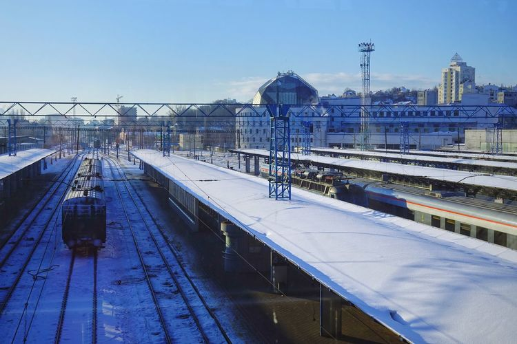 Kyiv-Pasazhyrskyi railway station, Kyiv, Ukraine. Transportation Outdoors Kyiv Kyiv,Ukraine Ukraine Ukraine 💙💛 Railroad Station Built Structure Architecture Building Exterior Rail Transportation No People Snow Cold Temperature Winter Springtime Top View Top Perspective Railroad Track Train Public Transportation Railroad Station Platform Mode Of Transportation Travel Track Connection Train - Vehicle Sky Day Station