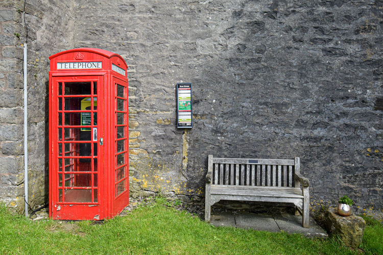 Red telephone booth on wall