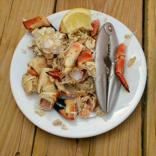 High Angle View Of Prepared Crabs In Plate On Table