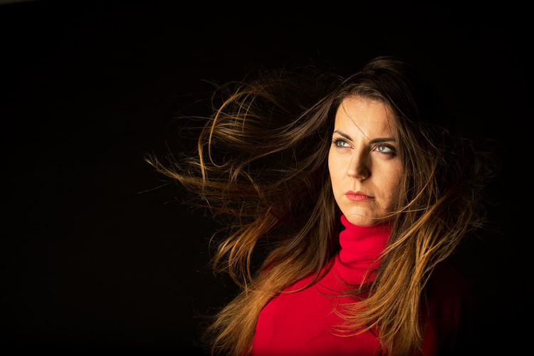 Portrait Black Background One Person Studio Shot Headshot Young Adult Beauty Beautiful Woman Looking At Camera Women Adult Hair Brown Hair Long Hair Copy Space Indoors  Tousled Hair Hairstyle Dark Contemplation Human Hair Wind