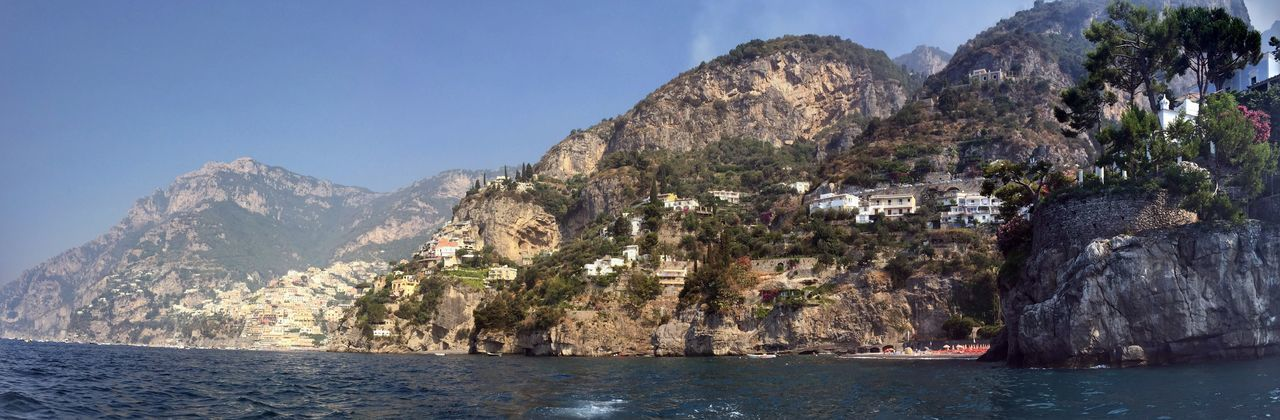 Mountain Water Sea Nature Sky Scenics - Nature Architecture Waterfront Beauty In Nature No People Rock Land Day Building Outdoors Mountain Range Built Structure Rock - Object Building Exterior Bay View Into Land Formation Amalfi Coast