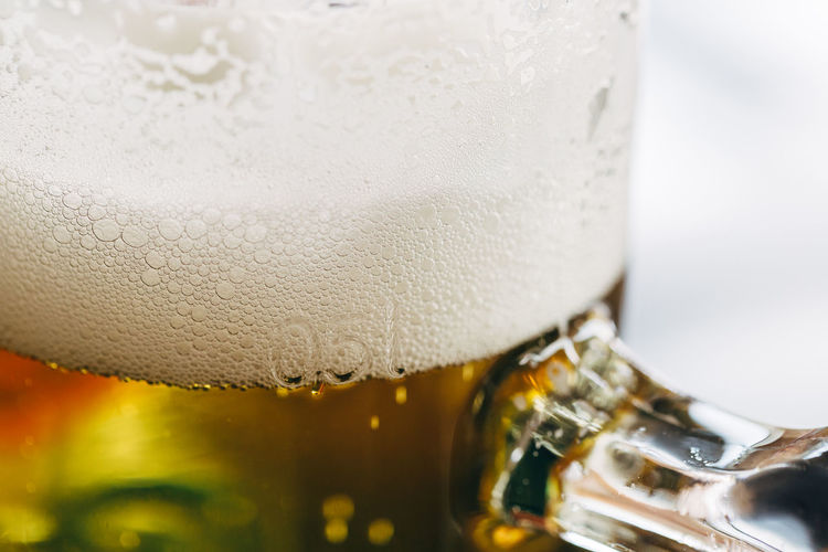 Close up of a half-liter glass of beer with frothy foam on top. Pint Alcohol Beer Beer - Alcohol Beer Glass Close-up Drink Drinking Drinking Glass Foam Food Food And Drink Freshness Froth Frothy Drink Glass Glass - Material Household Equipment Indoors  Refreshment Still Life Transparent