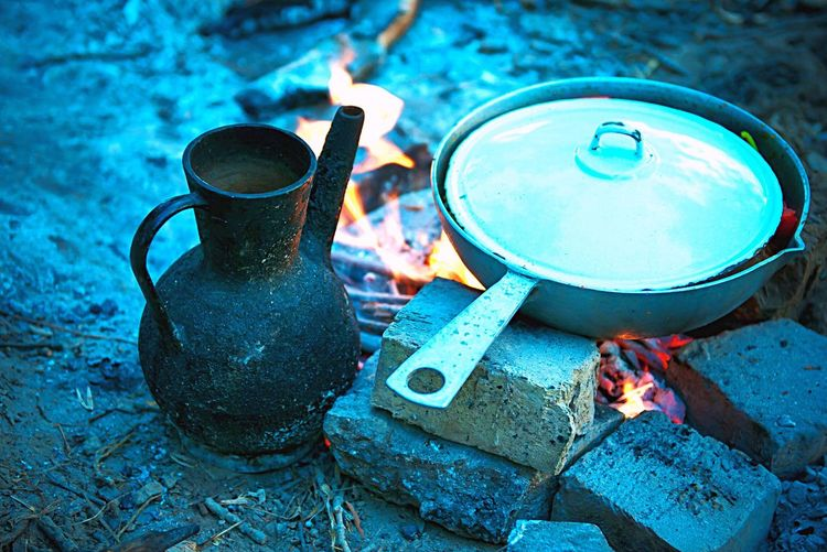 High Angle View Of Food In Cooking In Pan On Campfire