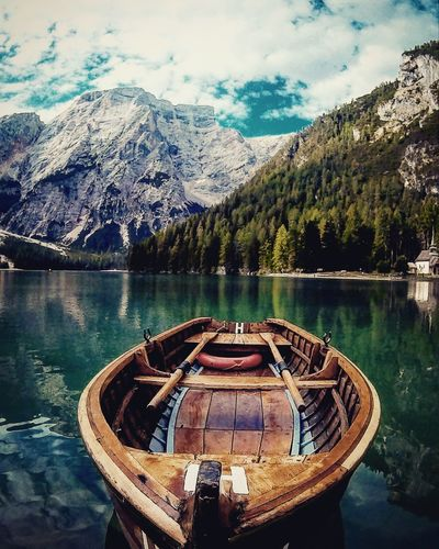 Mountain Transportation Nautical Vessel Mode Of Transport Tranquil Scene Mountain Range Lake Boat Non-urban Scene Travel Destinations Water Tranquility Scenics Beauty In Nature Moored Tourism Season  Vacations Tree Nature Eye4photography  EyeEmBestPics EyeEm Gallery Eyem Best Shot - My World Braies Lake