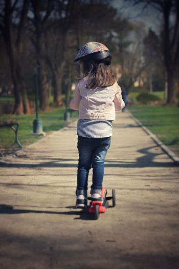 Kick Scooter Scooter Childhood Helmet Outdoor Activity Kids Kids Being Kids Fun Riding Preschool Age Preschooler Spring Sunny Day Active Lifestyle  Lifestyle Portrait EyeEm Selects Child Full Length Childhood Girls Rear View Casual Clothing