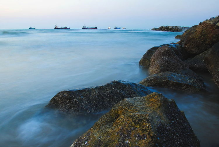Water Sea Rock Rock - Object Solid Scenics - Nature Beauty In Nature Sky Nature Tranquility Tranquil Scene No People Land Beach Rock Formation Motion Horizon Over Water Horizon Day Outdoors Rocky Coastline Evening Ship Twilight Transportation
