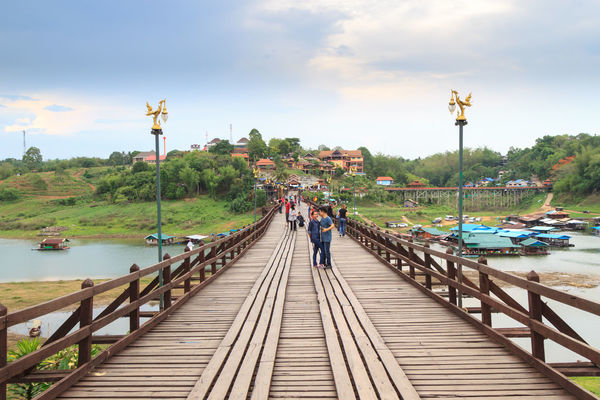 The Morn Bridge in Sangkhla Buri Architecture Beauty In Nature Bridge Bridge - Man Made Structure Building Exterior Built Structure Day Footbridge Mountain Mountain Range No People Outdoors River Sky Tranquility Travel Destinations Water Wood - Material Wooden Bridge