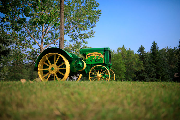Tree Rural Scene Blue Agriculture Wagon Wheel Field Wheel Sky Grass Landscape Agricultural Equipment Tractor Agricultural Machinery Farm Crop  Farmland Plantation Agricultural Field
