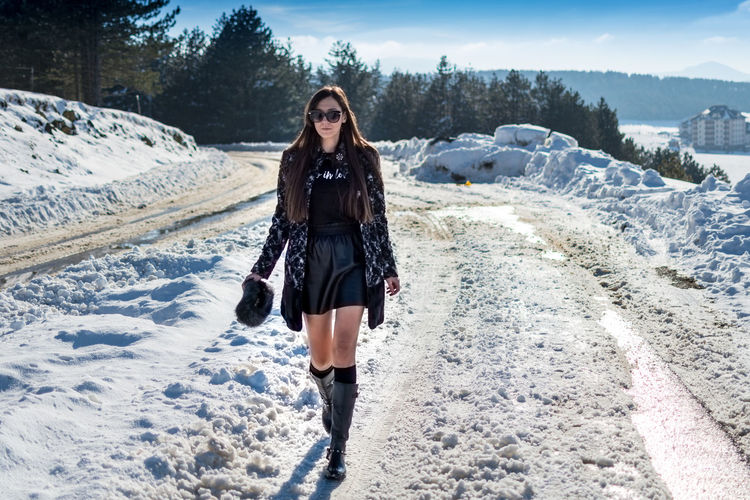 One Person Young Adult Real People Front View Lifestyles Winter Leisure Activity Full Length Snow Nature Young Women Clothing Cold Temperature Standing Adult Day Portrait Warm Clothing Outdoors Beautiful Woman Hairstyle