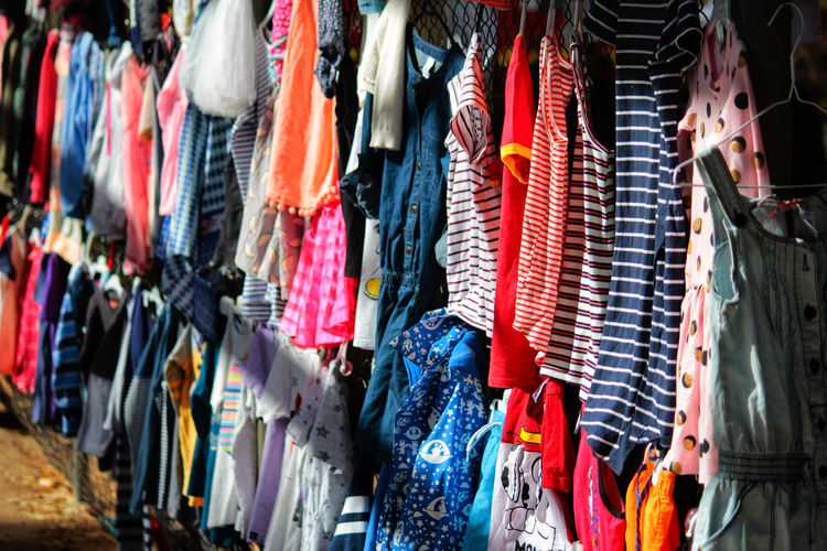 Full frame shot of colorful clothes for sale at market