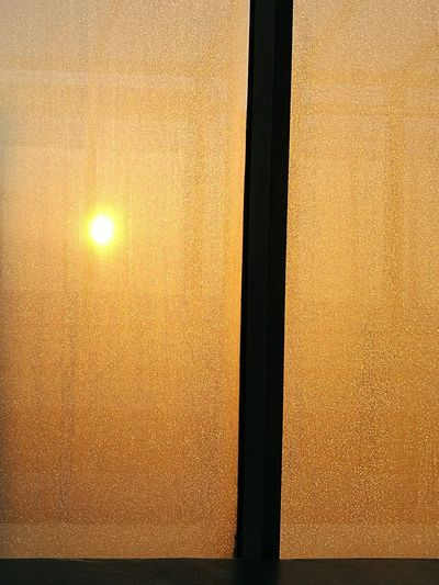 morning sun hidden behind the ice Sunset Window Frosted Glass Close-up