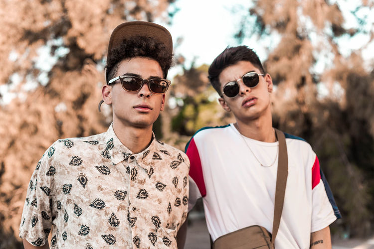 Portrait of young men wearing sunglasses