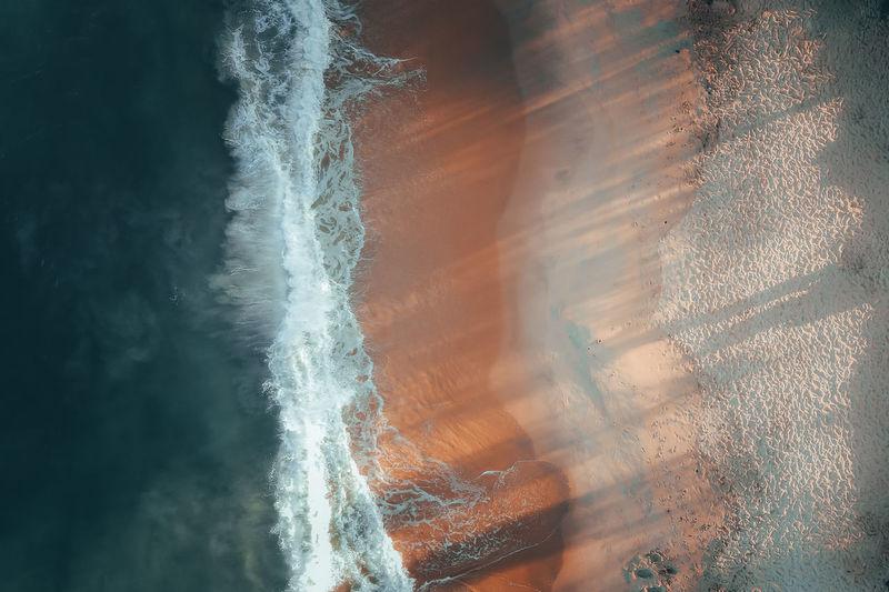 Close-up of water splashing in sea