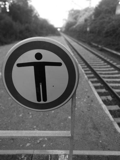 Close-up of road sign on railroad track