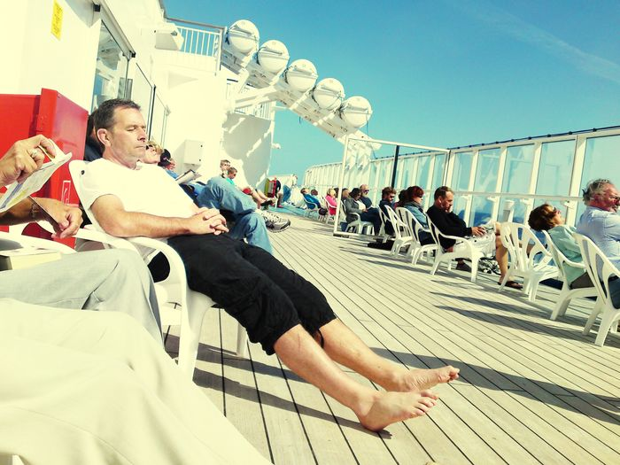 Easy and relax on board Many People Sunny Day Sunny Sunshine Ferry Kunst Art Zeitlos Langsamkeit Un Momento El MOMENTO Emotion Easyliving Easy Overseas Onboard Ship Schiff Real People Lifestyles Leisure Activity Men Sky People Sunlight