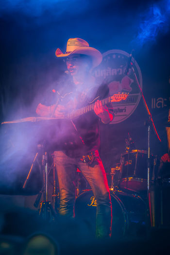 Cowboy Night Party at Nakhonsawan City, Thailand Cowboy Singer  Smoke Summer In The City The Maverick Arts Culture And Entertainment Concert Country Music Guitar Player Live Event Music Nightlife One Person Showing Stage คาวบอย นักร้อง มือกีต้าร์ เพลงคันทรี่ カントリーミュージック ギター奏者 主唱 吉他手 歌手 音樂會