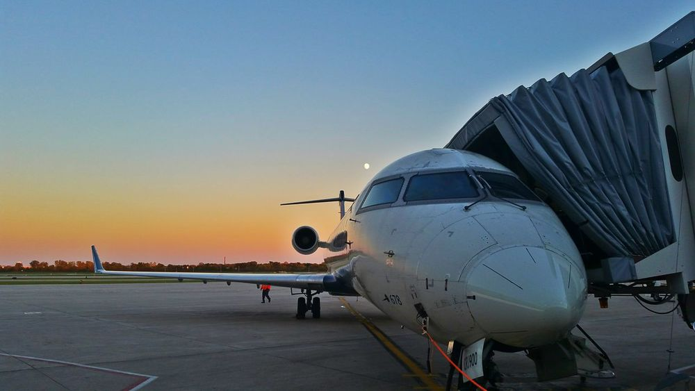 The rising near Full Moon rises behind a Delta Airlines AirPlane ✈ in the Evening Sunset in Milwaukee last week Airplane Transportation Airport Sky Commercial Airplane Aerospace Industry Air Vehicle