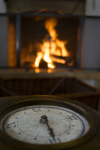 in front at the fireplace Christmas Interiors Atmosphere Clock Fire Fireplace In Front Indoors  Interior Time