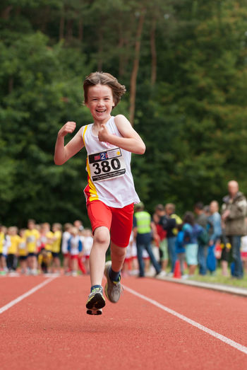 Athletic Athletics Child Children Day Enjoyment Focus On Foreground Full Length Fun Happiness Lifestyles Outdoors Race Raceday Running Selective Focus Track Sport The Color Of Sport