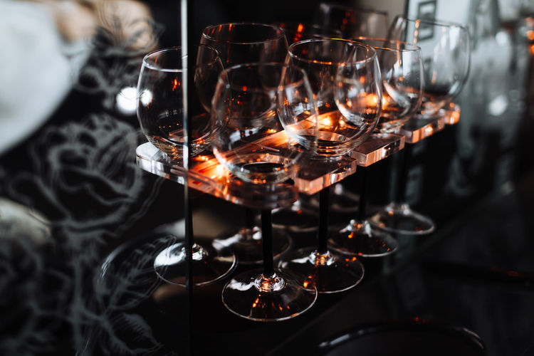 Close-up of wineglasses on rack