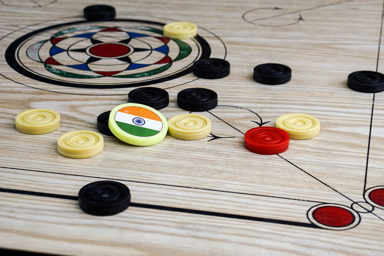 Indoors  No People Day Carrom Carromboard Play Game India Indoor Game White Black Flag Tournament Sport Hole Art Hand Fingger Movement