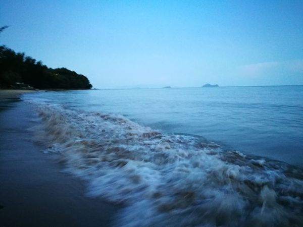 Sea Water Blue Beach Nature Beauty In Nature Sky Scenics Wave Landscape Tranquil Scene Malaysia Sarawak Travel Destinations No People Clear Sky Tranquility Outdoors Sunrise Beauty Tree Sand