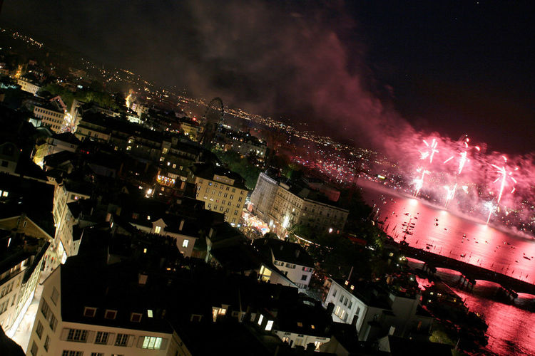 A firework during the Zürifäscht view from the Grossmünster church in the city of Zurich, Switzerland. Night Photography Zürich Architecture Building Building Exterior Built Structure City City Life Cityscape Firework Firework Display Glowing High Angle View Illuminated Lake Motion Nature Night No People Outdoors Residential District Skew Sky Skyscraper Zürifäscht HUAWEI Photo Award: After Dark