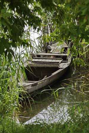 Beauty In Nature Boat Day Grass Green Color Growth Moored Nature Nautical Vessel No People Outdoors Plant Transportation Tree Water Watermill