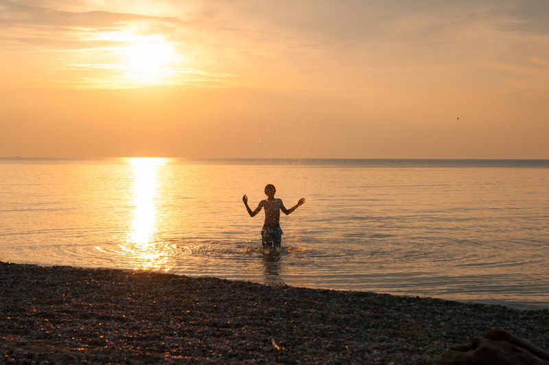 Children Lake Huron, Canada Swimming Beach Beauty In Nature Boyfriend Childhoodmemories Horizon Over Water Nature Outdoors People Pinery Provincial Park Reflection Scenics Sea Silhouette Sky Splashing Standing Sun Sunlight Sunset Tranquility Water