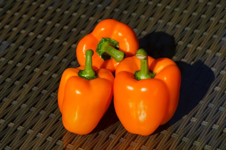 Three little peppers hanging on the table The Creative - 2018 EyeEm Awards Freshness Wellbeing Healthy Eating Pepper Bell Pepper Fruit No People Organic Table Orange Color Close-up Still Life Raw Food
