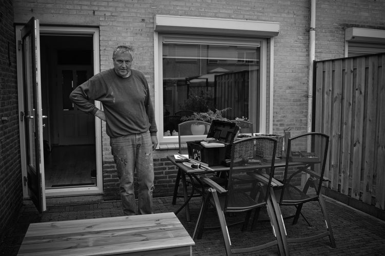 Portrait Of Carpenter Standing In Back Yard