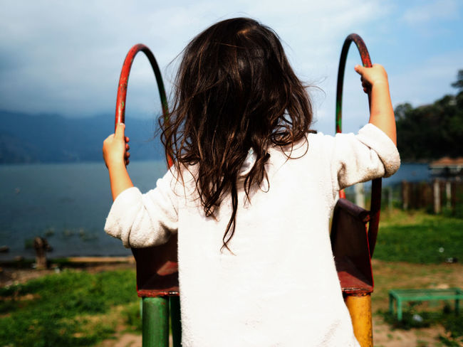 Climbing Atitlan Lake Beach Cheerful Child Children Day Happiness Holding Human Body Part One Person One Woman Only One Young Woman Only Only Women Outdoors People Playground Portrait Sky Slide Standing Women Breathing Space