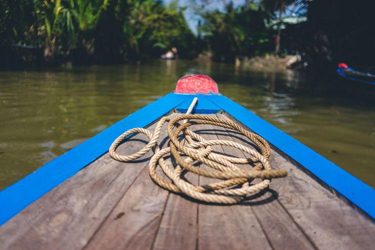 Boat Tour on the Mekong Water Nautical Vessel Rope Wood - Material Day Lake Tied Up No People Nature Outdoors Transportation Mode Of Transportation Focus On Foreground Moored Pier Close-up Tied Knot Strength Post Sailboat Rowboat Boat