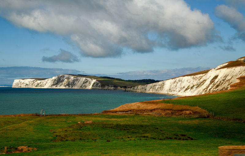Alum bay cliffside near the Needles on the isle of wight Cliffs Nature Wight Alum Bay Attraction Bay Blue Sky Cliffside Clouds Countryside Cove Fields Geology Grass Hillside Isle Land Landmark Landscape Rock Sea Sky Travel Pic Water White Cliffs