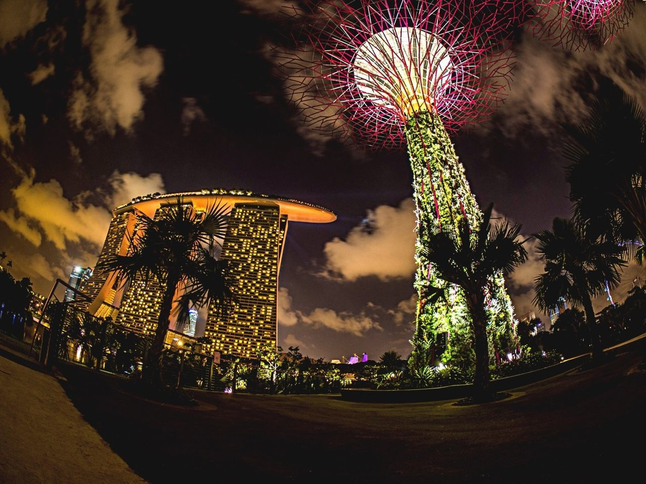 Low Angle View Of Marina Bay Sands And Gardens By The Bay Against Sky At Night