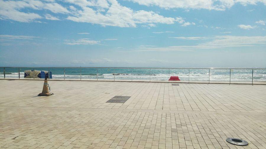 Empty promenade against sea