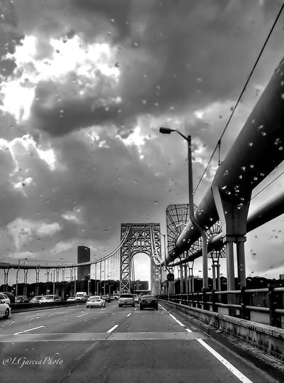 Rain drops..... Lgarciaphoto IPhone 7 Plus IPhone Iphoneonly Shot On IPhone IPhoneography New Jersey New Jersey Photography Jersey Bridge Architecture Built Structure Rain Clouds Sky Transportation Car Building Exterior Outdoors City Road Cloud - Sky Land Vehicle Day No People