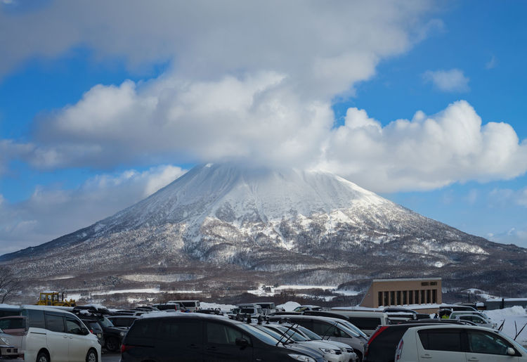 Beauty In Nature Cloud Cloud - Sky Covering Day Japan Land Vehicle Landscape Mountain Nature Non-urban Scene Outdoors Scenics Season  Sky Snow Snowcapped Snowcapped Mountain Tranquil Scene Tranquility Travel Destinations Volcano Weather Winter