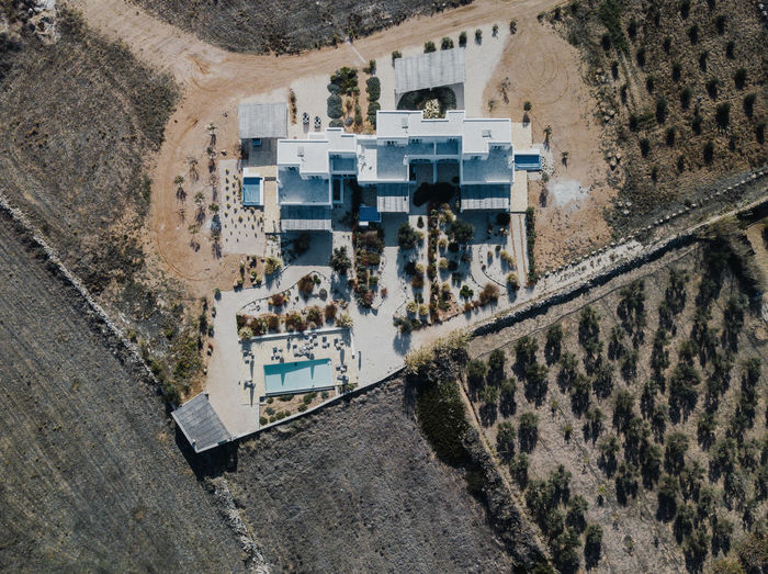 Aerial photo of a villa in Greece Architecture Building Exterior Built Structure High Angle View Building Aerial View Day Nature Travel Destinations City Plant Outdoors No People Travel Water Tree History Road The Past Scenics - Nature Arid Climate Villa Mediterranean