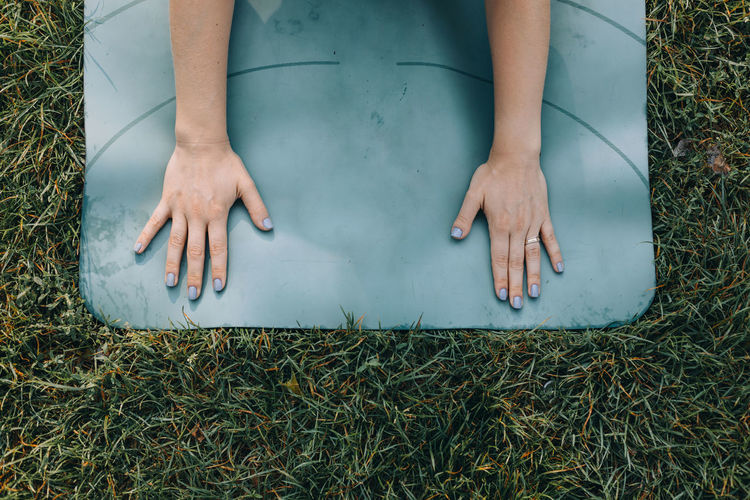 High angle view of woman stretching on a yoga mat