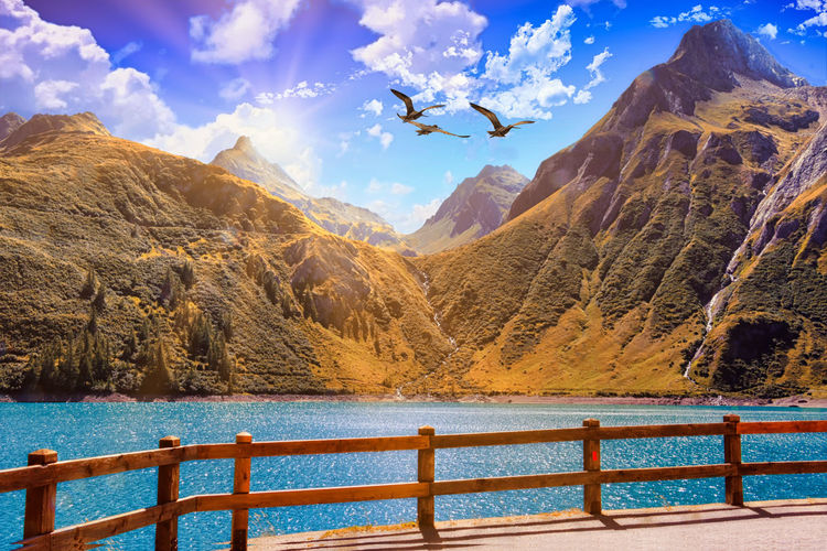 Barrier Beauty In Nature Boundary Cloud - Sky Day Formation Idyllic Lake Mountain Mountain Range Nature No People Non-urban Scene Outdoors Railing Scenics - Nature Sky Sunlight Tranquil Scene Tranquility Water